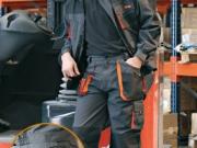 Conjunto cazadora y pantalon multibolsillos negro con naranja.jpg